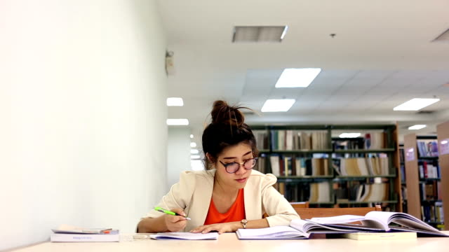 women education woman working in the library, study education textbook stock videos & royalty-free footage