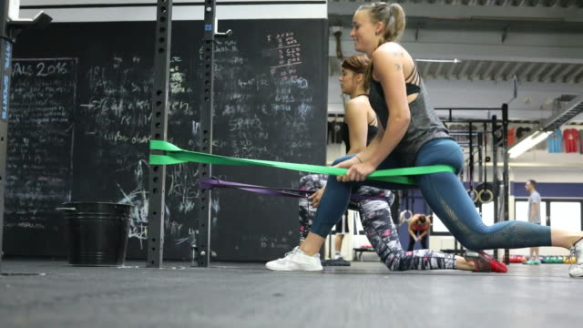 Women exercising with resistance bands in gym video