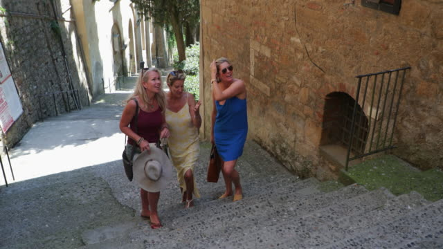 women exploring volterra - bachelorette party stock videos and b-roll footage