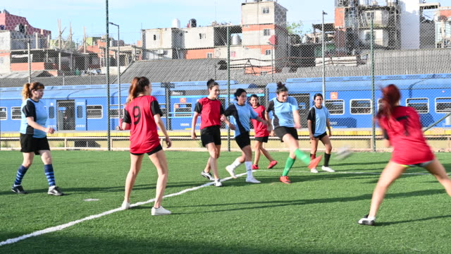 Women footballers passing and scoring in practice match