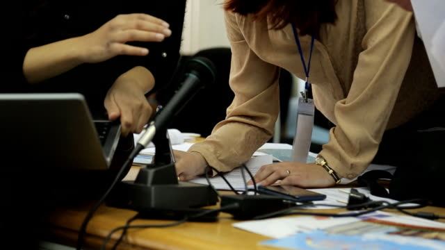 Women for paperwork, for compilation of report at office closeup video