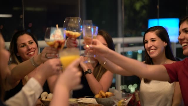 Women get together to enjoy a friendly dinner Its Christmas Time! girlfriend stock videos & royalty-free footage