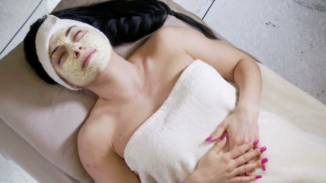 Women gets a facial  wearing a towel stock videos & royalty-free footage