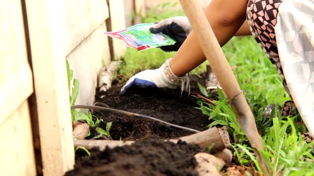 Women grow vegetables video