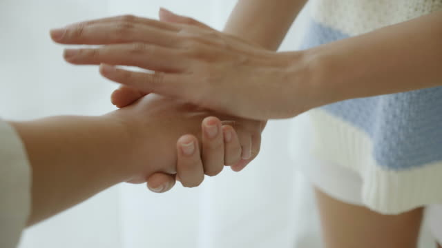 women hand close up friends handshake showing friendship, care and concern for physical health. consultation for body care concept of women's rights gender equality fight for equality - avvicinarsi video stock e b–roll