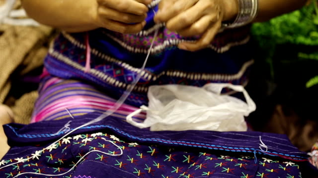 women hand sewing video