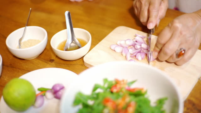 women hand sliced shallot with ingredients on the table - aglio cipolla isolated video stock e b–roll