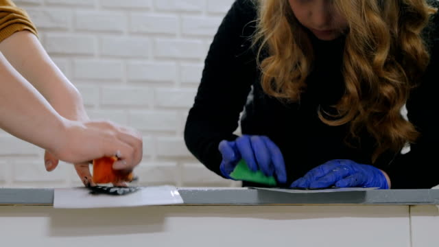 Women hands painting wooden circle video