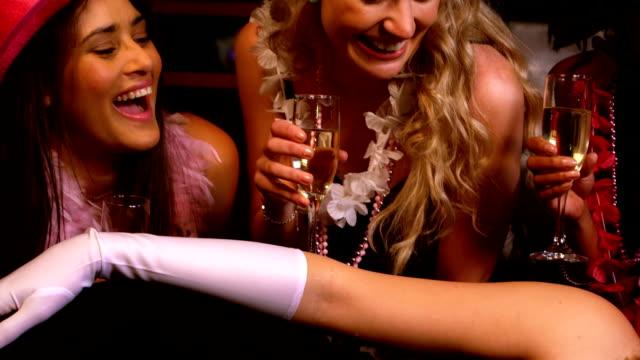 Women having a bachelorette party video