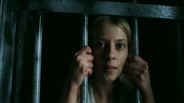 Women holding bars and looking through video