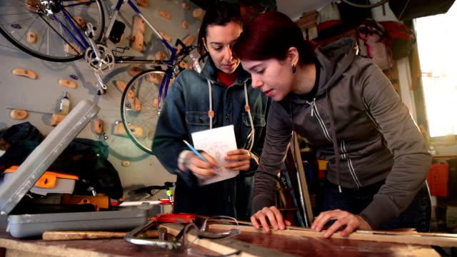 Women in business, working in a garage video
