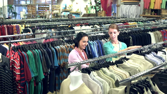 Women in clothing store shopping for men's shirts video