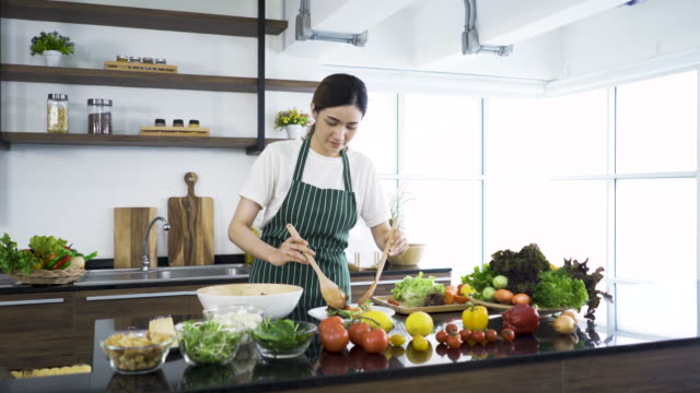 Women interested in good health mixing vegetable salad
