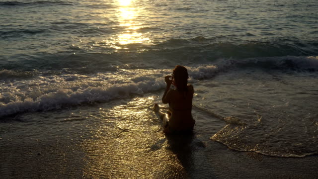 women is  playing with the waves at sea. - fethiye video stock e b–roll
