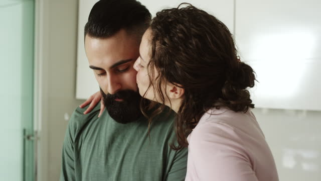 Women kissing men in kitchen video