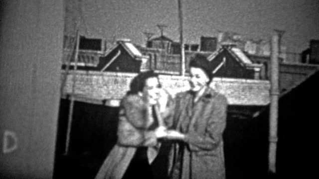 NEW YORK CITY - 1944: Women laughing and dancing together on an urban rooftop. video