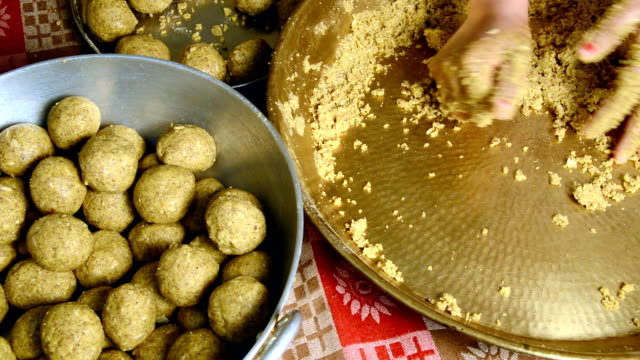 Women Making Laddu of Besan video