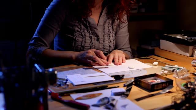Women making polymer clay jewelry video