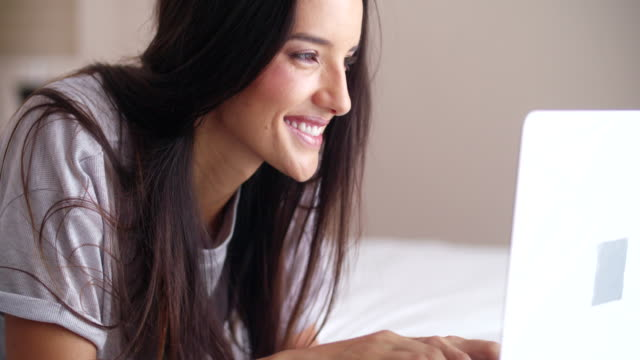 women on bed is surfing the internet on bed - pajamas stock videos & royalty-free footage