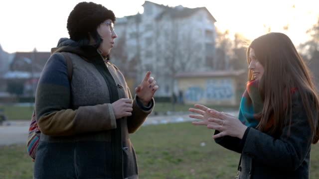 Women peaking in sign language