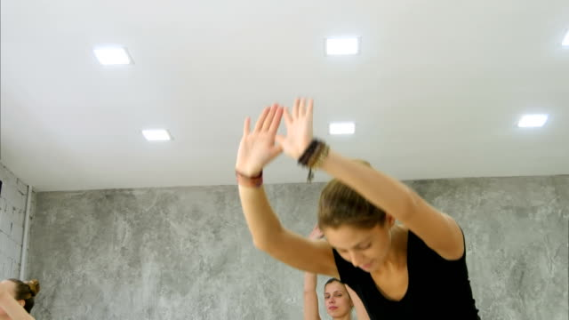 Women practicing yoga at health club video