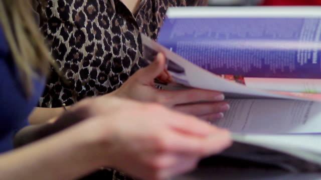 Women reading fashion vogue magazines, discussing news gossip video
