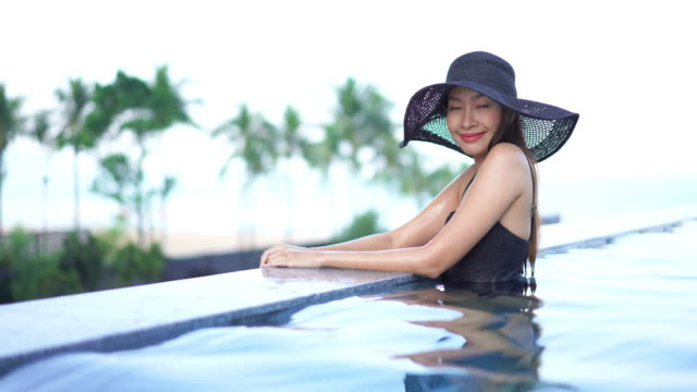Women relax happy around outdoor swimming pool