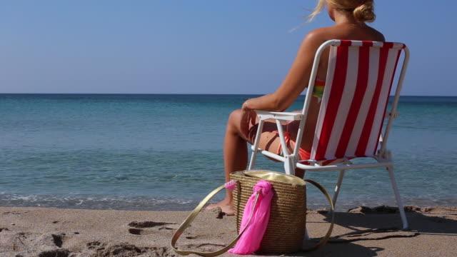 women  relax on beach look sea - morze egejskie filmów i materiałów b-roll