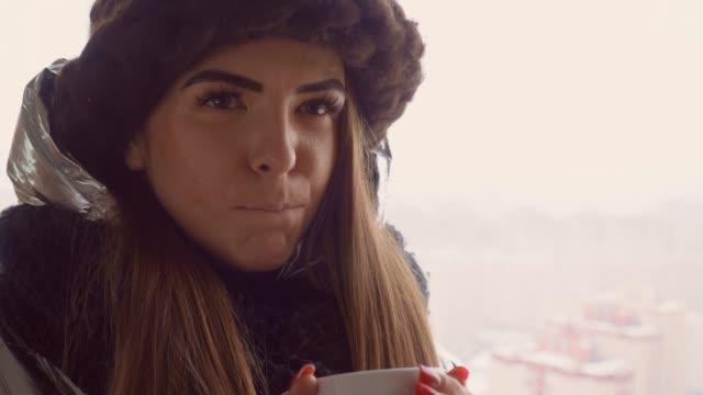 women relish coffee outdoor - bevanda calda video stock e b–roll