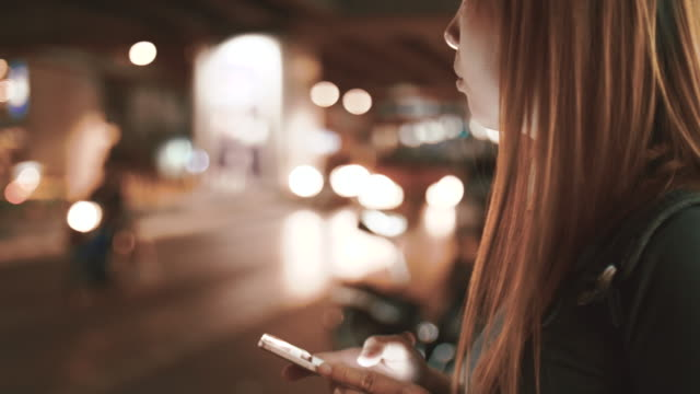 Women Requesting and Waiting Uber From A Smart Phone At Night video