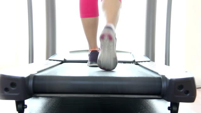 women running on Electric Treadmill video