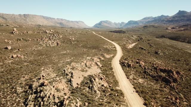 Women runs along a dirt road in the Cederberg Mountains video