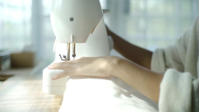 CU: Women sewing garment in sewing class video