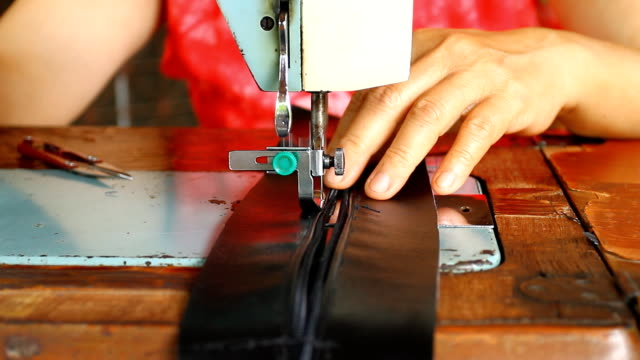 Women sewing with old machine video