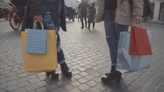 Women shopping and talking in Piazza di Spagna video