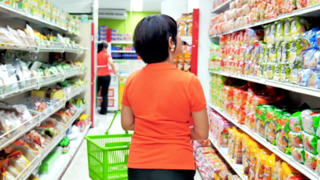 Women shopping in supermarket video