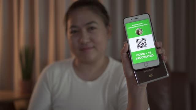 Women showing Certificate Digital Vaccine Passport video