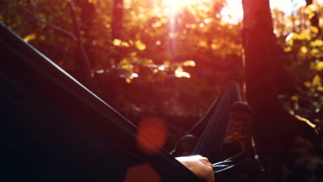 women sleeping in hammock - with colour correction - amaca video stock e b–roll
