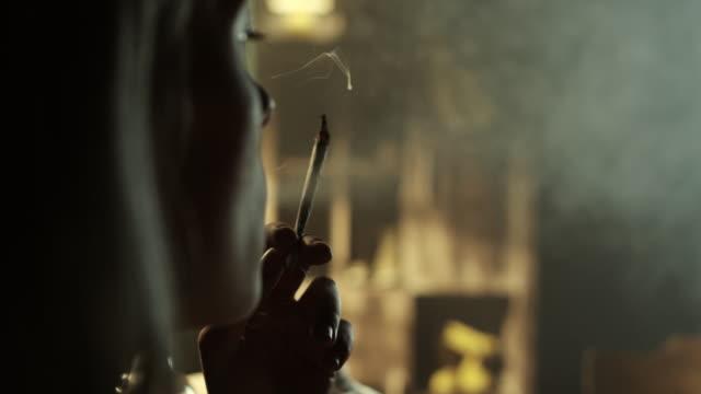 Women smoking marijuana joint video
