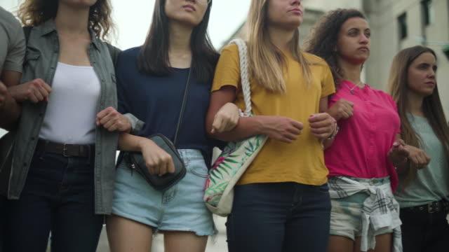 women standing together - fianco a fianco video stock e b–roll