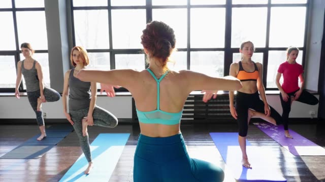 Women Stretching and Relaxing in Yoga Class video