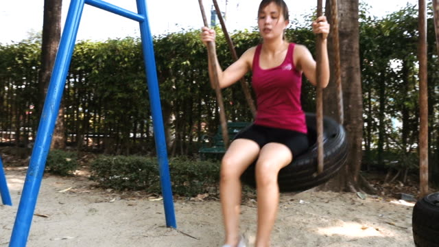 Women Swinging In The Playground video