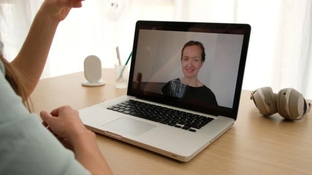 women talking on a webcam with wine - happy hour video stock e b–roll