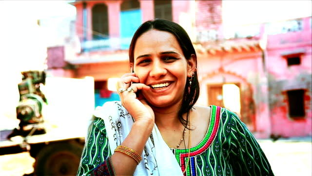 women talking on mobile phone video