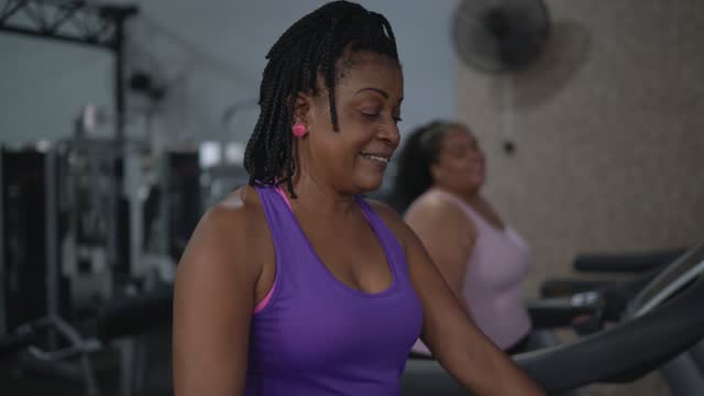 Women talking on treadmill at the gym
