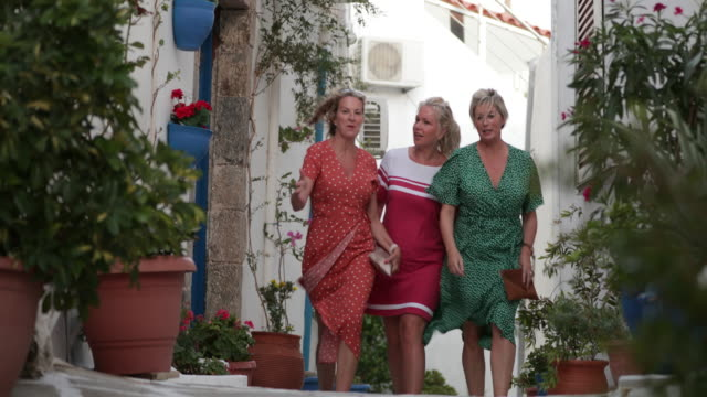 Women Tourists Walking Together