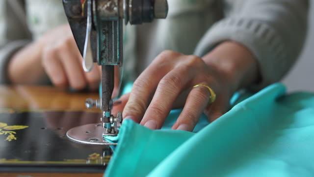 Women use sewing machine. video