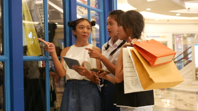 women using digital tablet and smart phone while shopping video