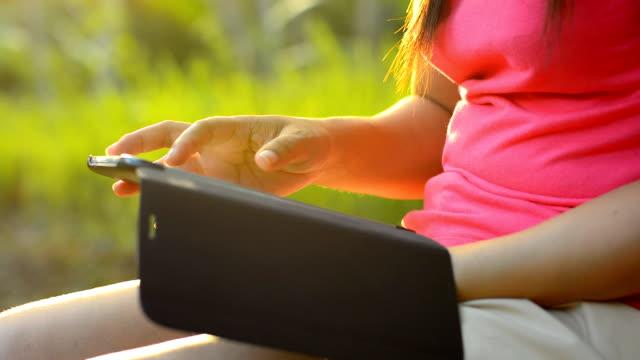 women using digital tablet computer at nature video