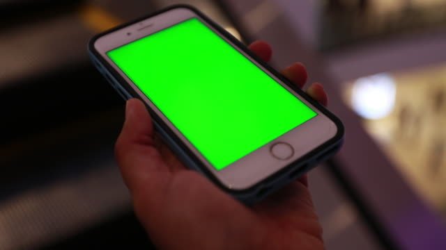 Women using smart phone with green screen video